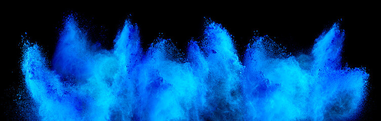 cyan blue holi paint color powder explosion isolated  dark black background. industry beautiful...