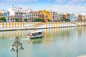 Wall Mural - Boat cruise on Guadalquivir river in city center of Seville, Spain