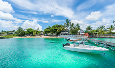 Wall Mural - Landscape with turquoise  water amd speed boats in Mauritius island, Africa