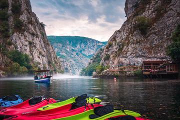 Fototapeta Canyon Matka near Skopje with people kayaking and amazing foggy scenery obraz