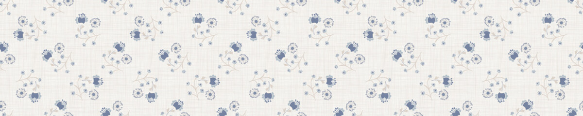 Seamless tossed floral pattern in french blue linen shabby chic style. Hand drawn country bloom texture. Rustic woven background. Kitchen towel home decor swatch. Simple flower motif all over print