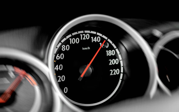 Car speedometer. High speed on a car speedometer and motion blur.