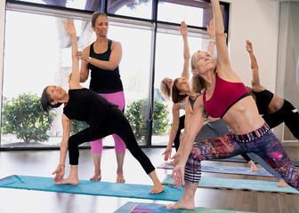 Yoga Instructor Teaching  Triangle Pose