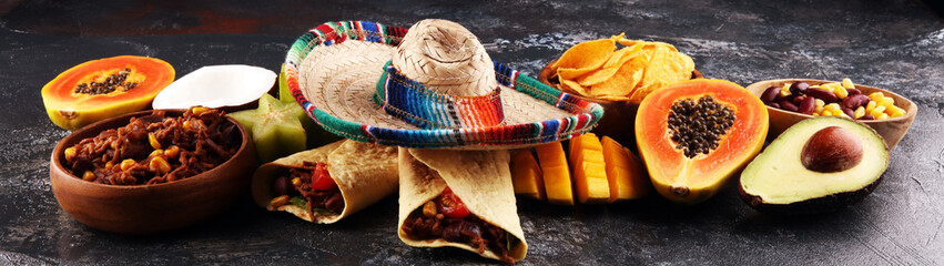 Mexican food mix in colorful colors. sombrero and mexican food with tacos