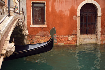 Keuken foto achterwand Gondolas View of canal with traditional gondola passing under a bridge in Venice - Italy.