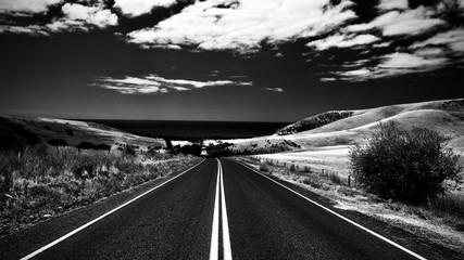 Fototapeten Grau Road By Landscape Against Sky