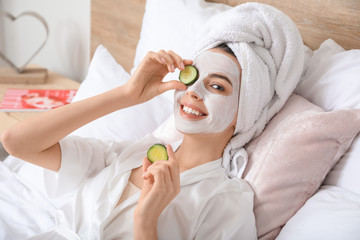 Morning of beautiful young woman taking care of her skin at home