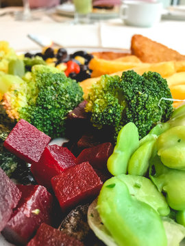 French fries, broccoli, hash brown potato, black beans, corn, beans and beets, healty vegan dinner