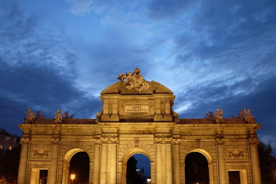Low Angle View Of Alcala Gate Against Cloudy Sky
