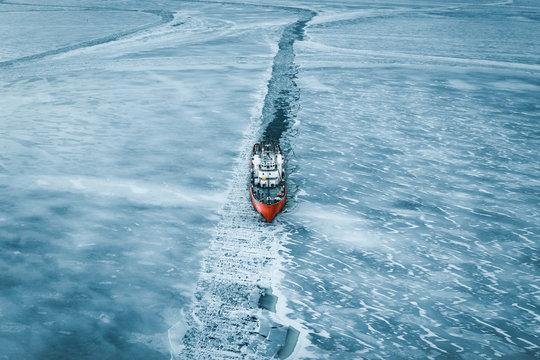 High angle view of ship moving through frozen Bothnian Sea