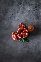 Ripe grains of pomegranate on the table. Pomegranate juice.