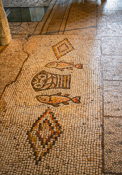 Tabha, Israel, Ancient mosaic, image of two fish and five loaves. Church of the Multiplication of Bread and Fish (Tabha) The concept is the history of Christianity.