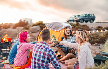 Canvas Prints Camping Happy friends toasting beers at barbecue camping party - Group young hipster people having fun dining and drinking together in campsite - Travel vacation lifestyle and youth culture concept