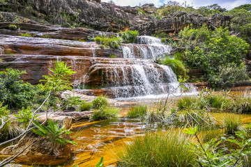Idyllic landscape with water cascades and shallow pond in lush vegetation, Biribiri State Park, Minas Gerais, Brazil