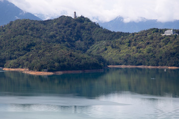 Fototapeten Camping Beautiful Sun moon lake with mountain view and reflection of mountain on the water. Taiwan