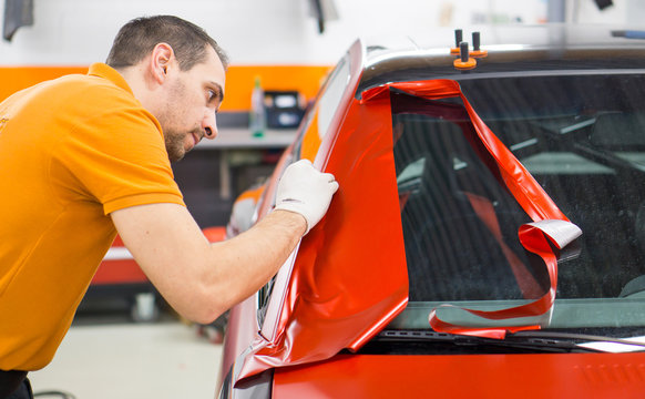 Car wrapping with red adhesive film