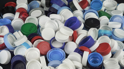 Plastic bottle caps for recycling. Recycling, solidarity and no plastic concept. Recycling of plastic caps and take care of the environment.