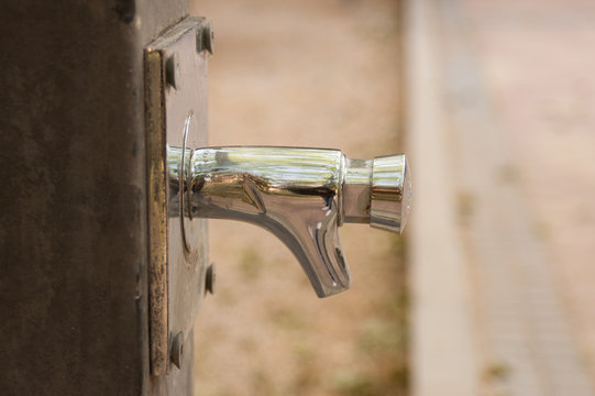 Close-up of contemporary tap of a street fountain in a park