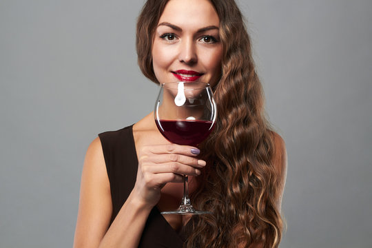 happy smiling woman with glass of wine