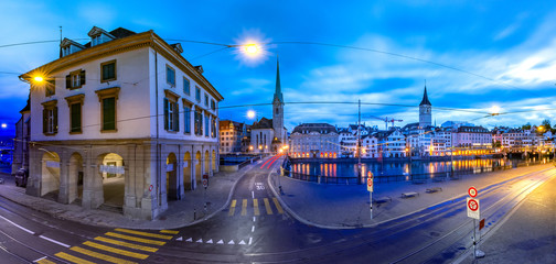 Fototapete - Famous Fraumunster and Church of St Peter and river Limmat Embankment during morning blue hour in Old Town of Zurich, the largest city in Switzerland
