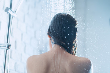 Asian woman taking a shower the back of her picture
