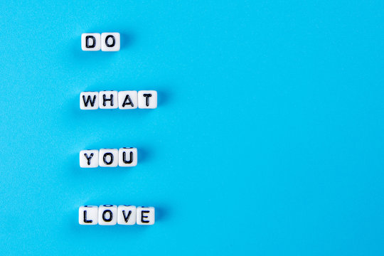 do what you love text on white dices with black letters