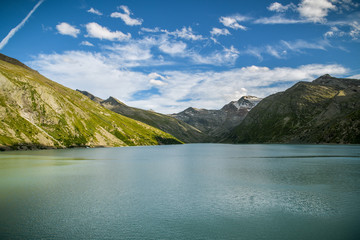 Wall Mural - View on Mattmark lake with beautiful Alps in background in upper part of Saas valley in Switzerland