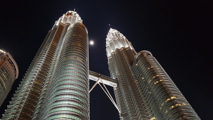 Wall Murals Kuala Lumpur Low Angle View Of Skyscrapers Lit Up At Night