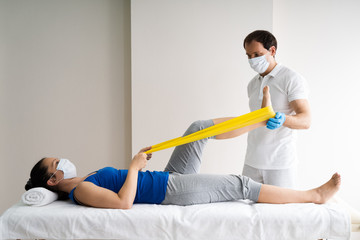 Physiotherapist Doing Band Exercise Therapy And Therapy