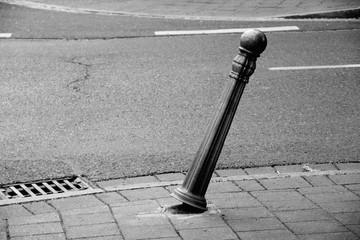 Fotomurales - Damaged Bollard On Sidewalk In City