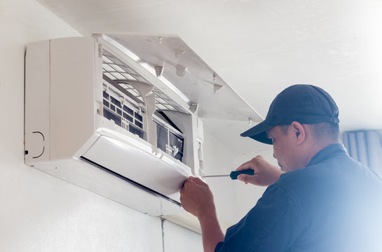 technician working service  air conditioner inroom
