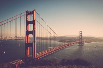Golden Gate Bridge Over Bay Against Sky