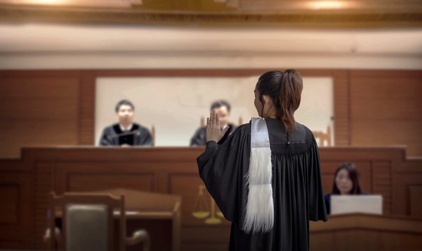 court room woman lawyer talk to attorney and  magistrate in trail court room o in feminine legal judgment