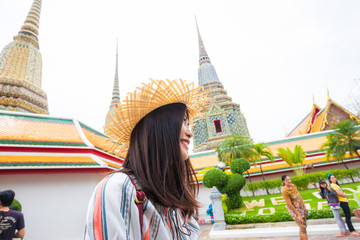 Wall Mural - Beautiful asian tourist women with backpack travel in Wat Pho buddhist temple