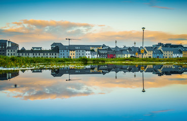 Galway, Ireland. Panoramic sunset view refleted on a puddle