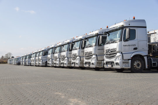 BURG / GERMANY - JUNE 11, 2017: german Mercedes Benz Actros trucks from haulage firm Neumann stands in a row.