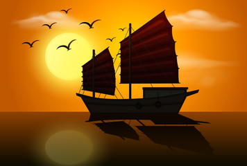 Silhouette scene with sailboat at sunset