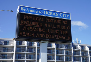 Sign welcomes visitors as coronavirus disease (COVID-19) restrictions are eased at Ocean City, Maryland