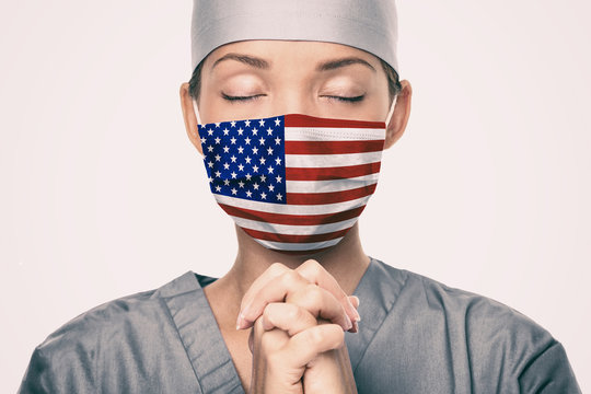 Coronavirus pandemic in the United States of America. USA american flag print on doctor's mask prayi