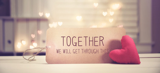 Together We Will Get Through This message with a red heart with heart shaped lights