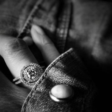 Close-up Of Woman Wearing Diamond Ring