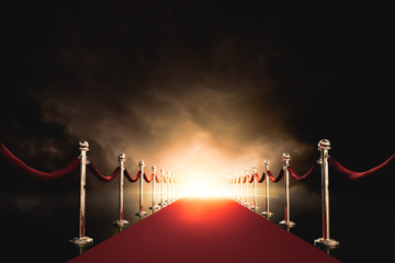 Red carpet with bright light in the end / 3D illustration