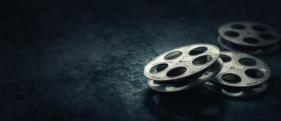 3D rendering of movie reels on a dark blue surface