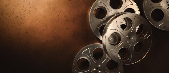 3D rendering of movie reels on a dark brown surface