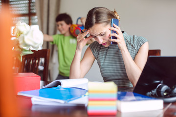 Stressed Businesswoman forced to work from home during lockdown