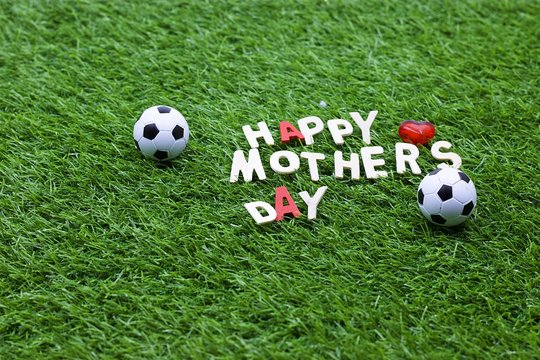 Happy Mother's Day for Soccer with football on green grass