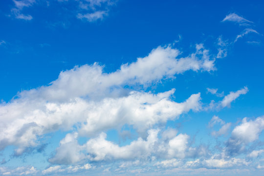 white fluffy clouds on the azure sky. stunning nature background