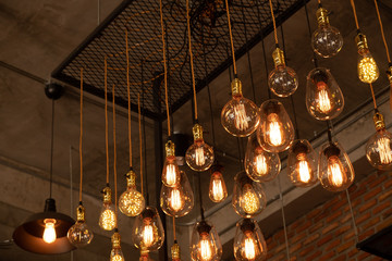 Wall Mural - House interior of loft and rustic style. Beautiful vintage luxury light bulb hanging decor glowing in dark. Retro filter effect style. Blend of history and modern.