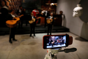 A Mariachi group records its performance for an online audience following a voluntary lockdown as the outbreak of the coronavirus disease (COVID-19) continues in Mexico City