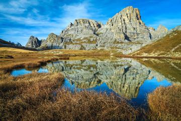 Fototapete - Wonderful mountain lake near Tre Cime di Lavaredo peaks, Italy